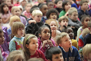 Students at John Ross Elementary School participate in a holiday singalong. Photo by David McDaniel, The Oklahoman David McDaniel - The Oklahoman