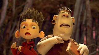 """This film image released by Focus Features shows the character Norman, voiced by Kodi Smit-McPhee, left, and Alvin, voiced by Christopher Mintz-Plasse, in the 3-D stop-motion film, """"ParaNorman."""" AP Photo"""