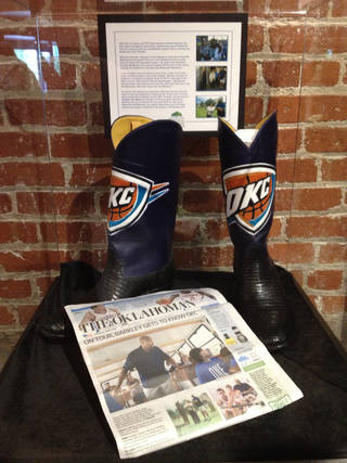 The boots given to Charles Barkley during his Oklahoma City visit. PHOTO PROVIDED BY OKLAHOMA CITY MEMORIAL & MUSEUM