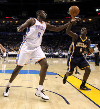 Oklahoma City's Nazr Mohammed (8) goes for the ball beside Indiana's Lance Stephenson (6) during the NBA basketball game between the Oklahoma City Thunder and the Indiana Pacers at the Oklahoma City Arena, Wednesday, March 2, 2011. Photo by Bryan Terry, The Oklahoman