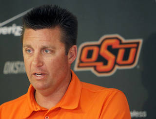 Head coach Mike Gundy speaks to the media during the OSU spring football press conference at Boone Pickens Stadium on the campus of Oklahoma State University in Stillwater, Okla., Monday, March 12, 2012. Photo by Nate Billings, The Oklahoman