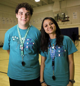 Brazilian students Gabriel Marques and Danielle Cardoso, who are in Oklahoma to work at YMCA summer camps, said children here are well-mannered. Photo by KT KING, The Oklahoman KT King - KT KING