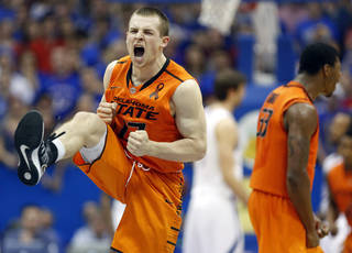 Oklahoma State's Phil Forte celebrates defeating Kansas in an NCAA college basketball game in Lawrence, Kan. on Saturday, Feb. 2, 2013. (AP Photo/The Wichita Eagle, Travis Heying) ORG XMIT: KSWIE101