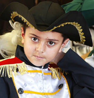 Above: Lane Youngblood wears a white wig for his role as Gen. George Washington on Wednesday at Schwartz Elementary School.
