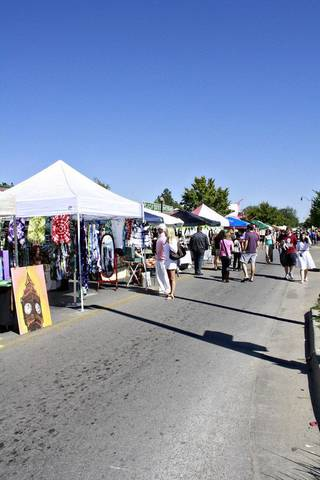 Festival-goers look at art during the 2011 Plaza District Festival. Photo by Maria Dru.