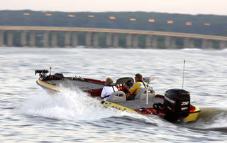 Pro angler Rick Ash leaves the docks during the 2007 Sooner Run at Grand Lake. MATT STRASEN