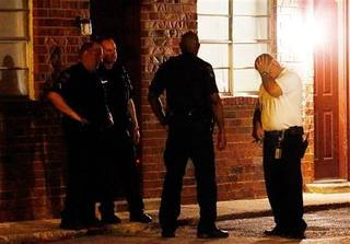 Police wait outside an apartment early Tuesday, Aug. 26, 2014, in Tulsa, Okla. where authorities say where four people, including two young children, have been shot to death in a possible triple murder-suicide. Tulsa police say a 35-year-old man fatally shot his estranged wife, their 5-year-old daughter and 3-year-old son before shooting himself. Authorities say the 2-year-old girl, who wasn't related to the alleged gunman, was in the apartment during the shooting but was not hurt. (AP Photo/Tulsa World, Tom Gilbert) ONLINE OUT; KOTV OUT; KJRH OUT; KTUL OUT; KOKI OUT; KQCW OUT; KDOR OUT; TULSA OUT; TULSA ONLINE OUT
