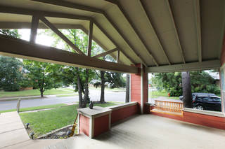 Mena Ganesan's home, in the Paseo neighborhood, has an expansive front porch. PAUL B. SOUTHERLAND - PAUL B. SOUTHERLAND
