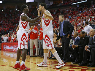 Houston's Patrick Beverley (12) and Carlos Delfino (10) celebrate next to Oklahoma City coach Scott Brooks during Game 4 in the first round of the NBA playoffs between the Oklahoma City Thunder and the Houston Rockets at the Toyota Center in Houston, Texas,Sunday, April 29, 2013. Oklahoma City lost 105-103. Photo by Bryan Terry, The Oklahoman