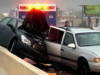 Rain and this multi-car accidents slowed traffic on Broadway Extension southbound near Wilshire on Wednesday, April 11, 2012, in Oklahoma City, Okla. Both cars are pointed north in the median of the southbound lane. Photo by Steve Sisney