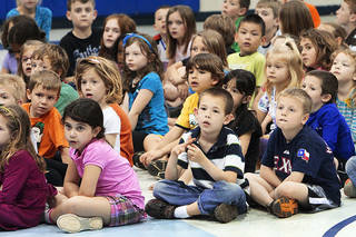 Students watch the members of the Oklahoma Veterans Flag Program demonstrate the proper way to fold an American flag at Prairie Vale Elementary School in Oklahoma City on Thursday. Photos By David McDaniel, The Oklahoman