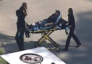 In this frame grab provided by KPRC Houston, an unidentified person is transported by emergency personnel at Lone Star College Tuesday, Jan. 22, 2013, in Houston, where law enforcement officials say the community college is on lockdown amid reports of a shooter on campus. (AP Photo/Courtesy KPRC TV) MANDATORY CREDIT ORG XMIT: CER104