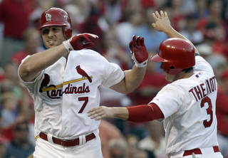 St. Louis Cardinals' Matt Holliday, left, is congratulated by Ryan Theriot after hitting his second home run of a baseball game against the Cincinnati Reds, during the fifth inning Tuesday, July 5, 2011, in St. Louis. (AP Photo/Jeff Roberson) ORG XMIT: MOJR108