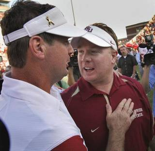 OU head coach Bob Stoops (left) and his brother Mark greet after the college football game where the University of Oklahoma Sooners defeated the Florida State University Seminoles (FSU) 47-17 at the Gaylord Family-Oklahoma Memorial Stadium on Saturday, Sept. 11 2010, in Norman, Okla. Photo by Steve Sisney, The Oklahoman STEVE SISNEY