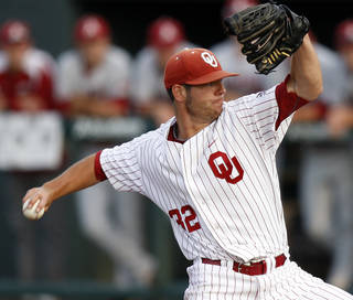 Oklahoma's Damien Magnifico pitches against Arkansas at L. Dale Mitchell Park in Norman, Okla., Tuesday, April 10, 2012. Photo by Bryan Terry, The Oklahoman