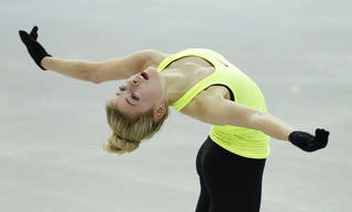 Gracie Gold, of the United States, skates Monday during a practice session at the figure stating practice rink at the 2014 Winter Olympics in Sochi, Russia. AP Photo Darron Cummings - AP