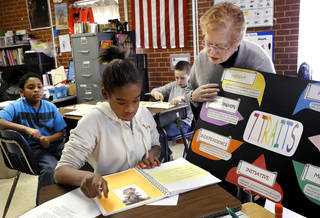 "Patricia Webb, executive director of The Silence Foundation, stops at Ahniela's desk to help her develops ideas for her poem. Some students at Positive Tomorrows, a school for homeless children, participate in the ""Resillience Project"" on Monday, March 4, 2013. Photo by Jim Beckel, The Oklahoman Jim Beckel - THE OKLAHOMAN"