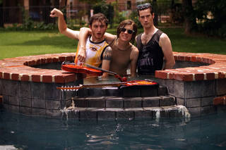 From left, John Calvin, Michael Loveland and Sean Barker pose for a Poolboy band photo during a music video shoot. Photo by Tim Katzenmeier.
