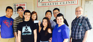 Asian American Student Association members presented a $1,080 check to Agape Medical Clinic represenatives Sue Ball, fourth from left, and Dr. Krista Brooks and Dr. Steve Pray, far right, to help purchase medication. The students raised the money through a date auction. They are, from left, Benny Lai, Tin Luong, Andrew Nguyen, Jennifer Pham and Brandon Truong, all of Mustang; and Johnathan Tran, Moore. Photo provided