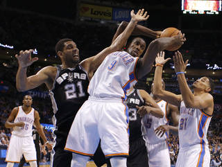 Oklahoma City's Serge Ibaka (9) grabs a rebound beside San Antonio's Tim Duncan (21) and Oklahoma City's Andre Roberson (21) during an NBA basketball game between the Oklahoma City Thunder and the San Antonio Spurs at Chesapeake Energy Arena in Oklahoma City, Thursday, April 3, 2014. Oklahoma City won 106-94. Photo by Bryan Terry, The Oklahoman