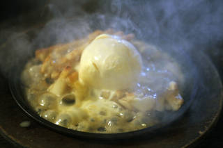 The Mexican Apple Pie at Chelino's is served on a sizzling comal with house-made ice cream and brandy butter. Photo by Paul Hellstern, The Oklahoman PAUL HELLSTERN - Oklahoman