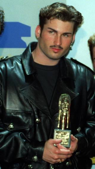 """**FILE** Bryan Abrams poses backstage at the Sixth Annual Soul Train Awards where his group, """"Color Me Badd,"""" won an award for Best R&B/Soul Single by a Group, in Los Angeles, March 10, 1992. Abrams' ex-wife, Shon Gables, has filed a civil lawsuit against Abrams whom she alleges owes more than $16,000 in back child support. Gables, a former Oklahoma City newscaster who now anchors WCBS news in New York City, appeared in Oklahoma County District Court earlier this week. (AP Photo/Doug Pizac)"""