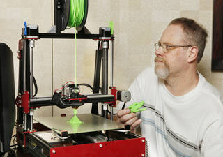 Jeff Davis, CEO of Maker's Tool Works, with the 3D printer manufactured at Makers Tool Works in Oklahoma City Wednesday, July 3, 2013. Photo by Paul B. Southerland, The Oklahoman