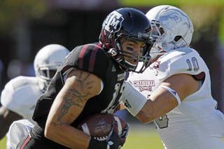 Texas A&M wide receiver Mike Evans (13) runs past Mississippi State linebacker Cameron Lawrence (10) with a pass reception in the first quarter of an NCAA college football game in Starkville, Miss., Saturday, Nov. 3, 2012. (AP Photo/Rogelio V. Solis) ORG XMIT: MSRS104