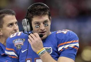 Former Florida quarterback Tim Tebow is seen wearing eye black with a message in this January AP photo.