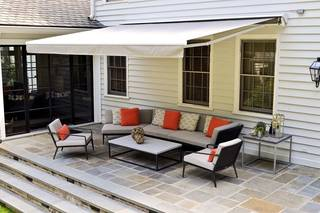 Moving the indoors out is a continuing trend in home decor. Custom-made furniture and a retractable awning are featured in this design (Atlanta Journal-Constitution/MCT) HANDOUT - MCT