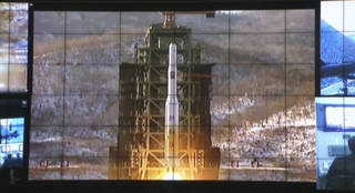 In this image made from video, displays show the Unha-3 rocket launch at North Korea's space agency's General Launch Command Center on the outskirts of Pyongyang, Wednesday, Dec. 12, 2012. The rocket launch will enhance the credentials of 20-something leader Kim Jong Un at home a year after he took power following the death of his father Kim Jong Il. It is also likely to bring fresh sanctions and other punishments from the U.S. and its allies, which were quick to condemn the launch as a test of technology for a missile that could attack the U.S. mainland. Pyongyang says it was merely a peaceful effort to put a satellite into orbit. (AP Photo via APTN) ORG XMIT: LON105