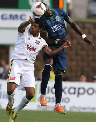 OKC's Peapo Doue, right, and Rochester's Jossimar Sanchez battle for the ball during a USL Pro soccer game at Pribil Stadium on Sunday. Photo by Sarah Phipps, The Oklahoman