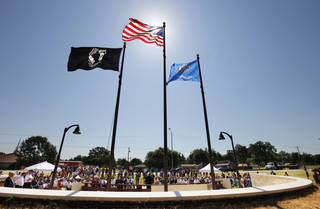 The POW-MIA, American and Oklahoma flags raised during dedication ceremonies for the Midwest City Veteran's Memorial in Joe B. Barnes Regional Park in Midwest City Friday. Photo by Paul B. Southerland, The Oklahoman PAUL B. SOUTHERLAND - PAUL B. SOUTHERLAND
