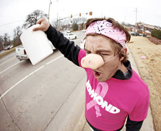 Edmond Memorial sophomore Will King, 16, stands at 15th Street and Bryant to raise money for Swine Week. Funds raised went to The Jimmy Everest Center for Cancer and Blood Disorders in Children. PHOTO BY BRYAN TERRY, OKLAHOMAN ARCHIVE