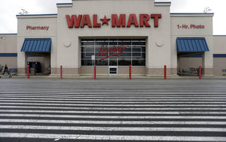 A Walmart store is shown in Bristol, Pa. Walmart's third-quarter profits increased, but the world's largest retailer cut its annual outlook. AP Photo Matt Rourke