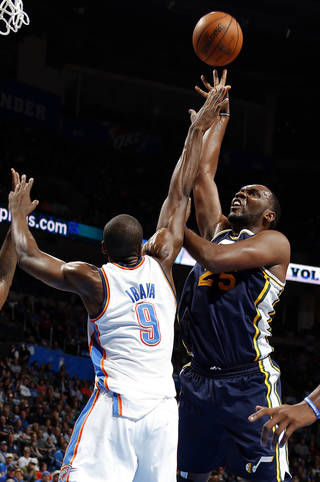Oklahoma City's Serge Ibaka (9) defends against Utah's Al Jefferson (25) during the NBA game between the Oklahoma City and the Utah Jazz and the Chesapeake Energy Arena, Friday,Nov. 30, 2012. Photo by Sarah Phipps, The Oklahoman