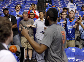 Fans try to get the attention of Oklahoma City's James Harden before Game 3 of the first round in the NBA playoffs between the Oklahoma City Thunder and the Dallas Mavericks at American Airlines Center in Dallas, Thursday, May 3, 2012. Photo by Bryan Terry, The Oklahoman