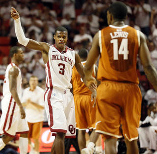 Oklahoma's Buddy Hield (3) celebrates in front of Texas' Julien Lewis (14) during a men's college basketball game between the University of Oklahoma and the University of Texas at the Lloyd Noble Center in Norman, Okla., Monday, Jan. 21, 2013. OU won, 73-67. Photo by Nate Billings, The Oklahoman
