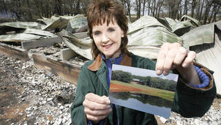 Tammy England shows a photo of Cory's Cabin before it was destroyed in Thursday's fires north of Lindsay. The cabin was built to honor her son who died of a brain aneurism when he was 17. photo BY DAVID MCDANIEL, THE OKLAHOMAN