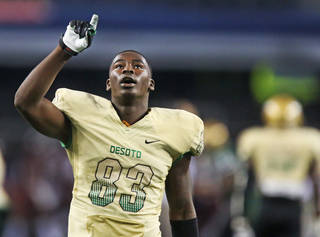 DeSoto's Vontre McQuinnie (83) gestures as he leaves the field after the Eagles' 34-30 win during the DeSoto High School Eagles vs. the Coppell High School Cowboys football playoff game at AT&T Stadium in Arlington on Saturday, November 23, 2013. (Louis DeLuca/Dallas Morning News)