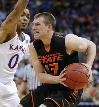 Oklahoma State's Phil Forte, right, looks to shoot beside Kansas' Frank Mason during Thursday's game. Forte scored 16 points as the Cowboys lost 77-70 in overtime.