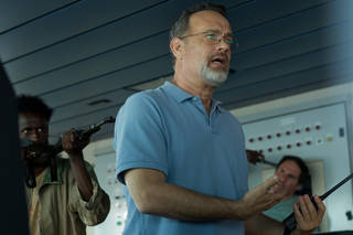 "This photo released by Sony - Columbia Pictures shows actor Tom Hanks in a scene from the film, ""Captain Phillips,"" releasing in the US on Friday, Oct. 11, 2013. Some amateur actors from Minneapolis made their film debut acting alongside the two-time Academy Award winner, Hanks. The four actors of Somali descent appear as Somali pirates in ""Captain Phillips,"" which stars Hanks as the captain of a cargo ship hijacked off the Horn of Africa in 2009. (AP Photo/Copyright Sony - Columbia Pictures, Hopper Stone, SMPSP) ORG XMIT: CAPH602"