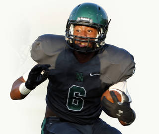 Norman North's Z'Quan Hogan runs against Edmod Santa Fe during a high school football scrimmage at Harve Collins Field in Norman, Okla., on Thursday, Aug. 21, 2014. Photo by Steve Sisney, The