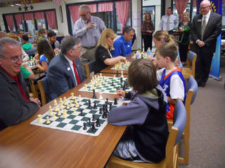 Members of the Rotary Club of Edmond, a supporter of Ida Freeman Elementary, take chess lessons and compete with the nationally ranked school team that will compete in the national competition Saturday. PHOTO PROVIDED -