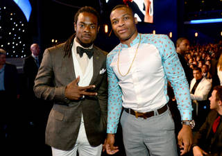Richard Sherman, left, and Russell Westbrook pose in the audience at the ESPY Awards at the Nokia Theatre on Wednesday, July 16, 2014, in Los Angeles. (Photo by Jordan Strauss/Invision/AP)