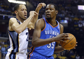 Oklahoma City's Kevin Durant (35) looks to the basket as Memphis' Tayshaun Prince (21) defends during Game 6 in the first round of the NBA playoffs between the Oklahoma City Thunder and the Memphis Grizzlies at FedExForum in Memphis, Tenn., Thursday, May 1, 2014. Photo by Bryan Terry, The Oklahoman