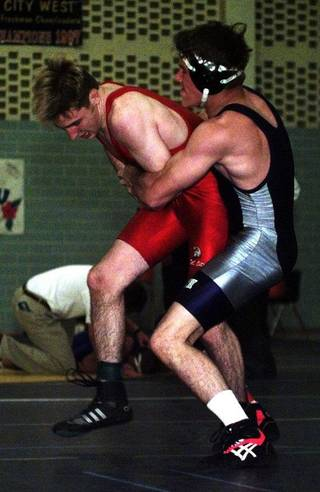 Jeff Scott of Edmond North tries to take down Josh Valentine of Del City during the 1997 All-City high school Wrestling Classic. Scott went on to win. Photo by Steve Sisney, The Oklahoman Archive STEVE SISNEY