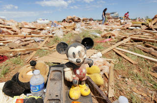 Mickey Mouse toys belonging to Steve Peil, nicknamed Mickey Mouse, sit with other items found in the debris at the Hide-A-Way Mobile Home Park in Woodward, Okla., Monday, April 16, 2012, after a tornado struck the park early Sunday morning. Peil died after being rushed by helicopter from the park. Photo by Nate Billings, The Oklahoman