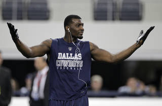 Dallas Cowboys wide receiver Dez Bryant gestures during warm-ups before an NFL football game against the Miami Dolphins on Thursday, Nov. 24, 2011, in Arlington, Texas. (AP Photo/Matt Strasen) ORG XMIT: CBS101