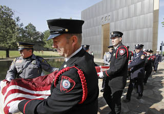 Oklahoma City police officers and firefighters carry the 911 flag through the memorial to the museum after the Day of Remembrance Ceremony, Tuesday, April 19, 2011. This was the 16th annual Oklahoma City Bombing Memorial ceremony. Photo by David McDaniel, The Oklahoman